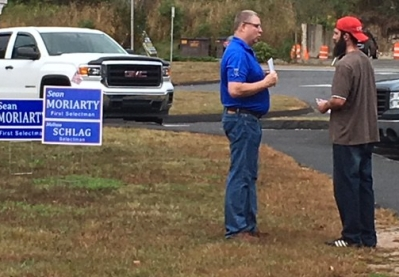 Sean speaking with a resident at the post office plaza.