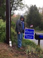 Campaigning in the rain...more than once. First Selectman candidate Sean Moriarty is given permission to post a sign after speaking with a town resident.